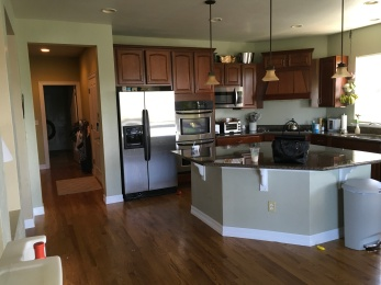 replace countertops, stove-top, sink, backsplash, paint cabinets and walls, add pillars, shutters